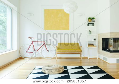 Sofa Between Bicycle And Shelf