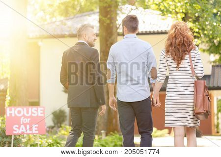Engaged Couple And Businessman