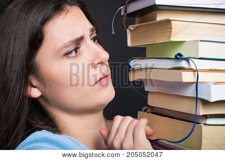 Sad Young Student Holding Many Books