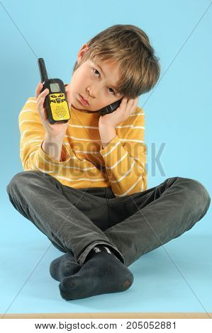 Boy Playing With A Walkie Talkie
