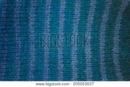 Colorful pattern ow a hand made wool socks. Natural clothing. Bright colors close up pattern.