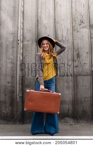 Stylish Girl With Suitcase