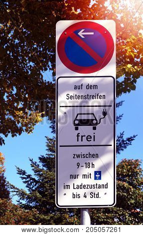 Parking prohibited Traffic sign - Sign Electric car free with parking ticket in charge - Charging to public charging station - Electric mobility