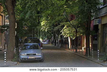 Sofia Bulgaria - August 1 2017: people are walking by the narrow street in Sofia Bulgaria