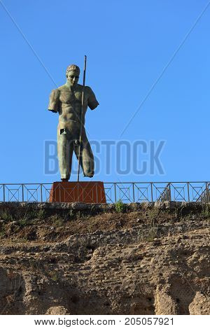 Ancient Statue Of Warrior In Pompey Dead Town In Italy Under Blue Sky Background