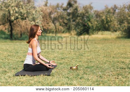 Young woman relax and exercising in. Freedom, calm and yoga concept