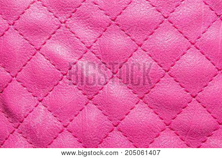 Pink quilted leather. Stylish background pattern. bright color.