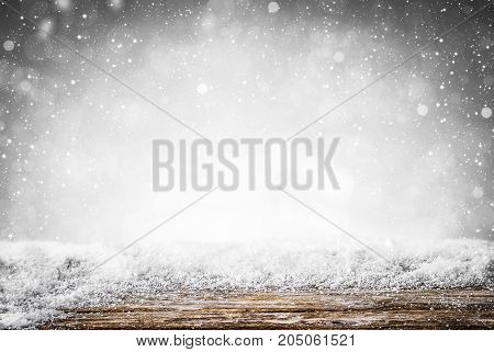 Silver abstract snow falling winter christmas holiday background with sparkles and glitter.
