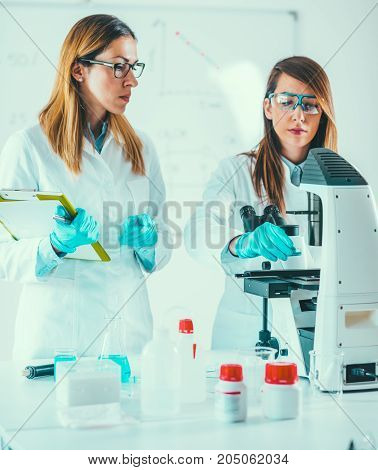 Biotechnology. toned image two women, vertical image
