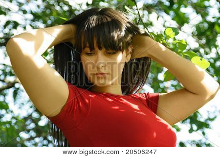 Young Girl In Red Shirt, Hands Behind Head, Summer Park