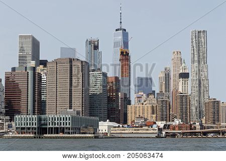 NEW YORK CITY, USA, September 11, 2017 : View of Manhattan skyline from the middle of East River.