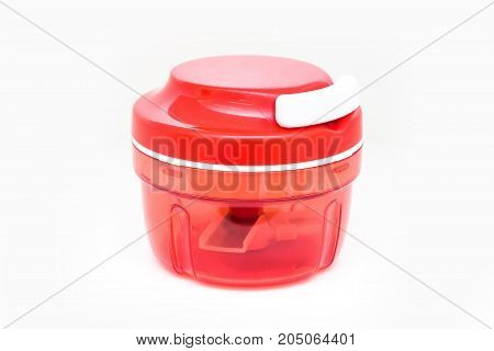 Close up modern red and white food shredder isolated on white background