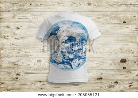 Grey shirt with earts on it over wood background. Elements of this image furnished by NASA