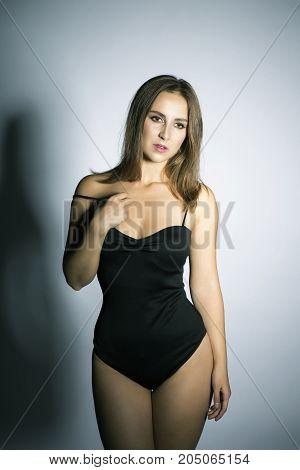 Oversized nice brunette model portrait studio shot