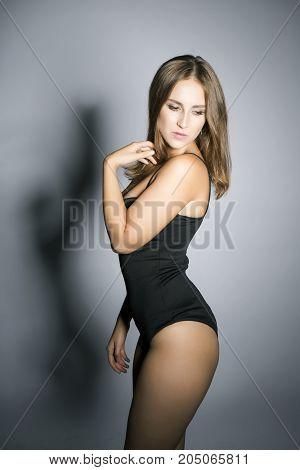 Beautiful oversized model sexy posing in studio