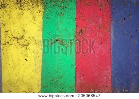 Concrete wall painted in colors of yellow, green, red and blue, abstract color background
