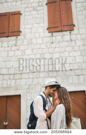Happy tourist couple in love traveling outdoors