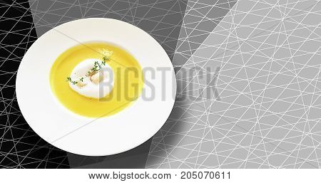 Homemade fresh Pumpkin soup with creamcrispy bread and basil on black and white graphic backgrounds.