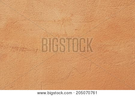 Closeup on Light brown painted on exterior rough stucco wall Texture Italian style Background.