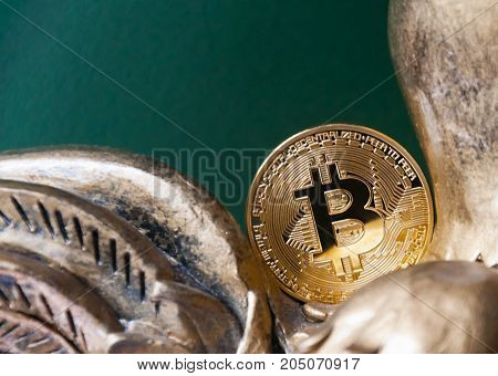 The gold coin Bitcoin lies and does not fall into a piggy bank. Symbolizes the end of 2017. Concept of crypto currencies.
