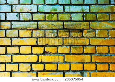 Gold yellow brick wall texture with scratched grungy surface