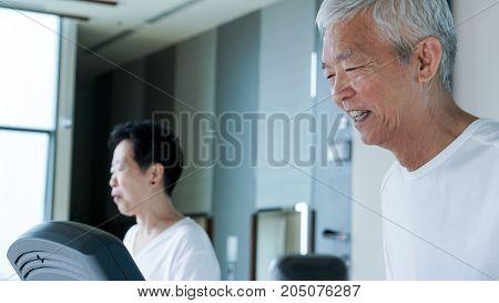 Happy Asian Senior Couple Running On Treadmill Healthy Lifestyle