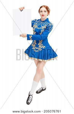 Beautiful woman in costume for irish dance with empty banner isolated