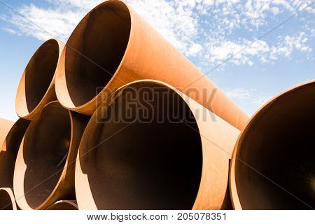 large rusty metal pipes as a background .