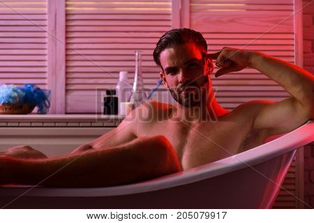 Sex And Erotica Concept: Macho Sitting Naked In Bathtub