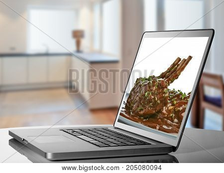 Looking A Recipe Of Cooking At Laptop