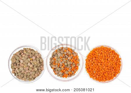 Chickpeas, orange lentils in and green, isolated on white. Studio Photo