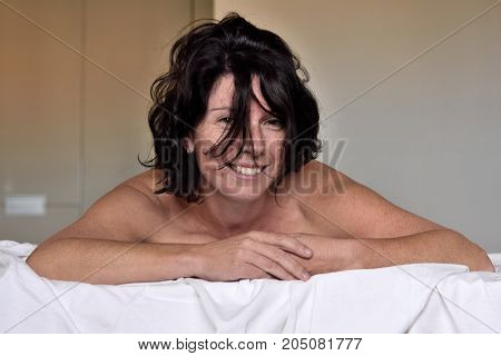 Portrait Of A Smiling Woman On The  Bed