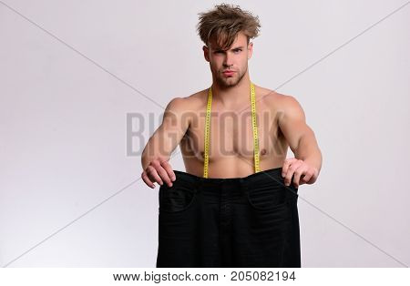 Athlete With Messy Hair And Half Naked Torso