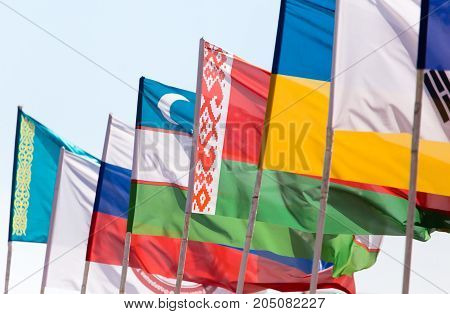 flags of different countries against the blue sky .