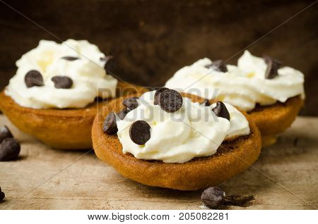 Homemade cookies with whipping cream and chocolate chips on top