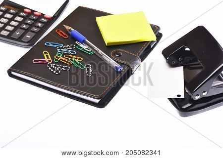 Calculator And Stationery Isolated On White Background
