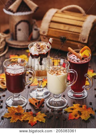 Delicious desserts. Smoothies. Autumn scenery, dried maple leaves and coffee beans. Tasty composition. A set of delicious drinks. White Chocolate, Cream, Creamy Cocktails and mulled wine