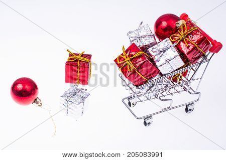 Trolley with christmas presents on white background. Studio Photo