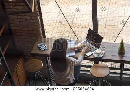 Young freelancer checking emails on laptop to answer customer's question