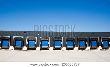 Row of loading docks with shutter doors at a warehouse