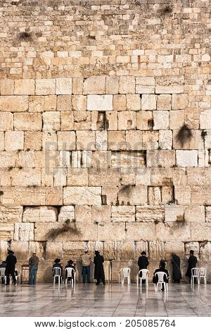 JERUSALEM ISRAEL - JAN 26 2011: Jewish worshipers pray at the Western Wall in Jerusalem Israel.