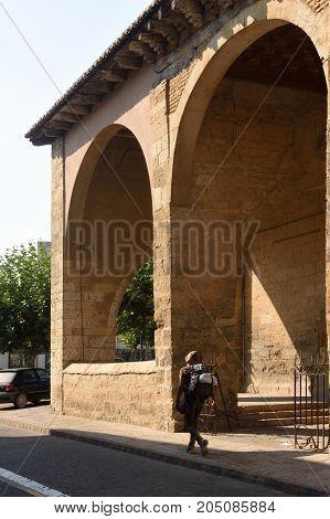 Pilgrim in front of the Romanesque church of Santa Maria Carrion de los Condes Spain
