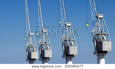 Row of harbor cranes in the Port of Antwerp.
