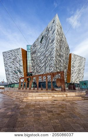 BELFAST NORTHERN IRELAND - FEB 9 2014: Titanic Belfast visitor attraction and a monument.