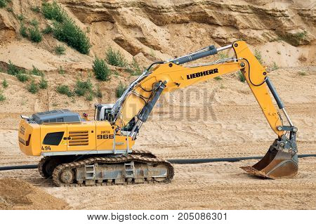 GARZWEILER GERMANY - JUL 2 2017: Liebherr R-966 crawler excavator in the Garzweiler open-pit mine used for earthmoving and quarrying work.
