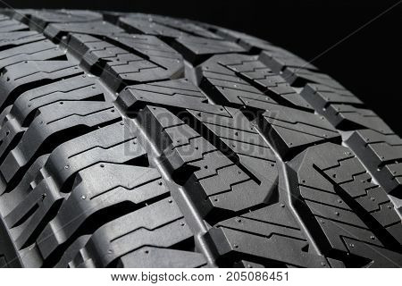 car tire profile on a black background.