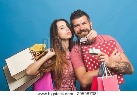 Bearded Man With Smiling Face Holds Shopping Bags