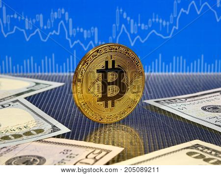 Golden bitcoin coin on blue abstract finance background. Bitcoin cryptocurrency