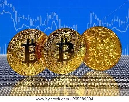 Golden bitcoin coins on blue abstract finance background. Bitcoin cryptocurrency