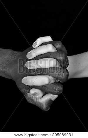 A Hands Of Black Man And White Woman On Black Background